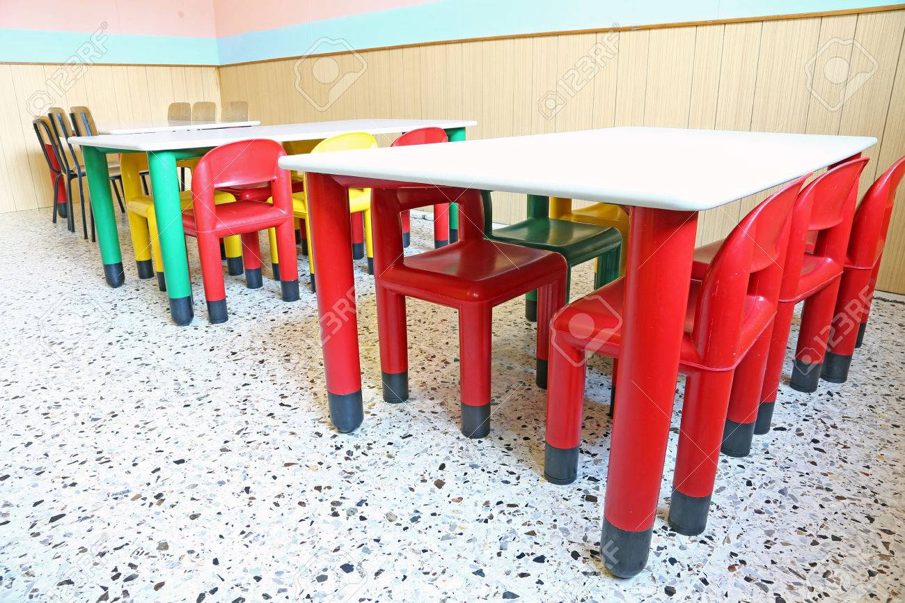 Plastic Chairs And Small Tables In The Nursery Class Stock Photo - Nursery tables and chairs