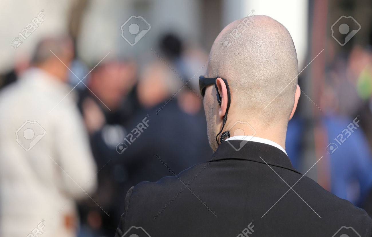 bald security guard with the headset to control people Stock Photo - 37751994