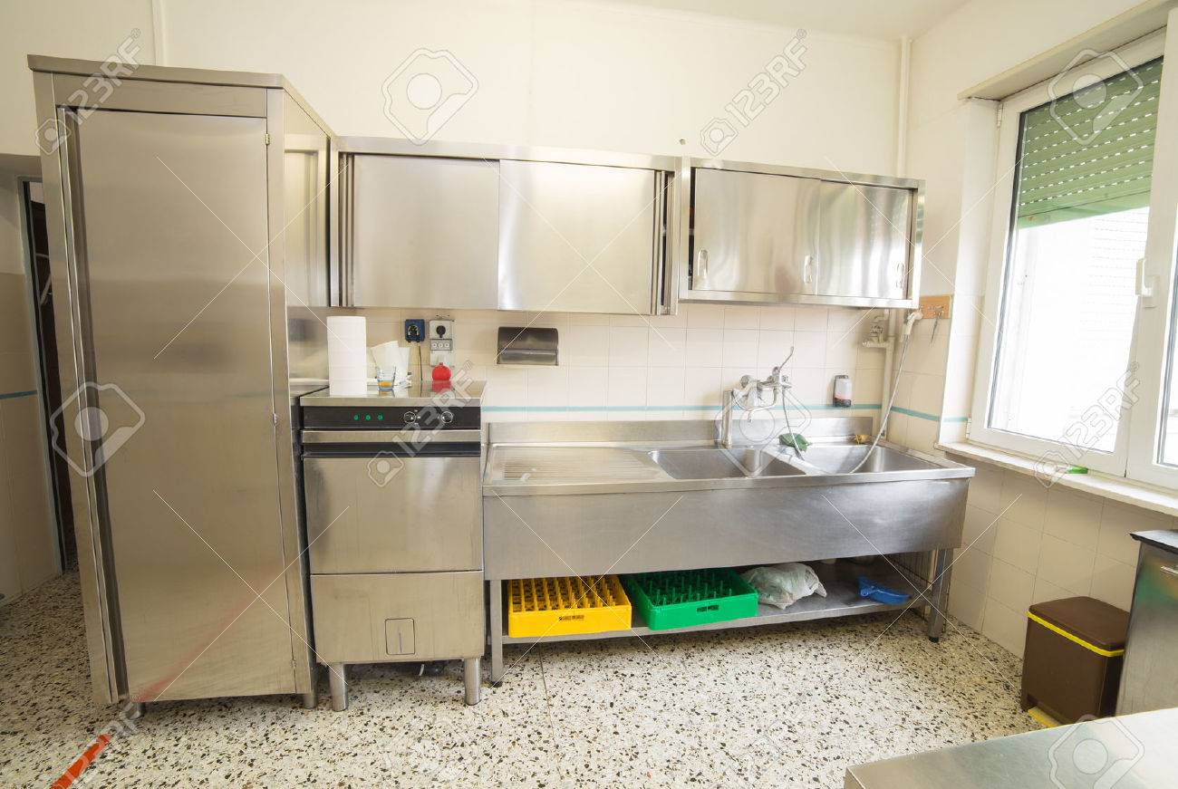 Large Industrial Kitchen With Refrigerator, Dishwasher And Sink ...