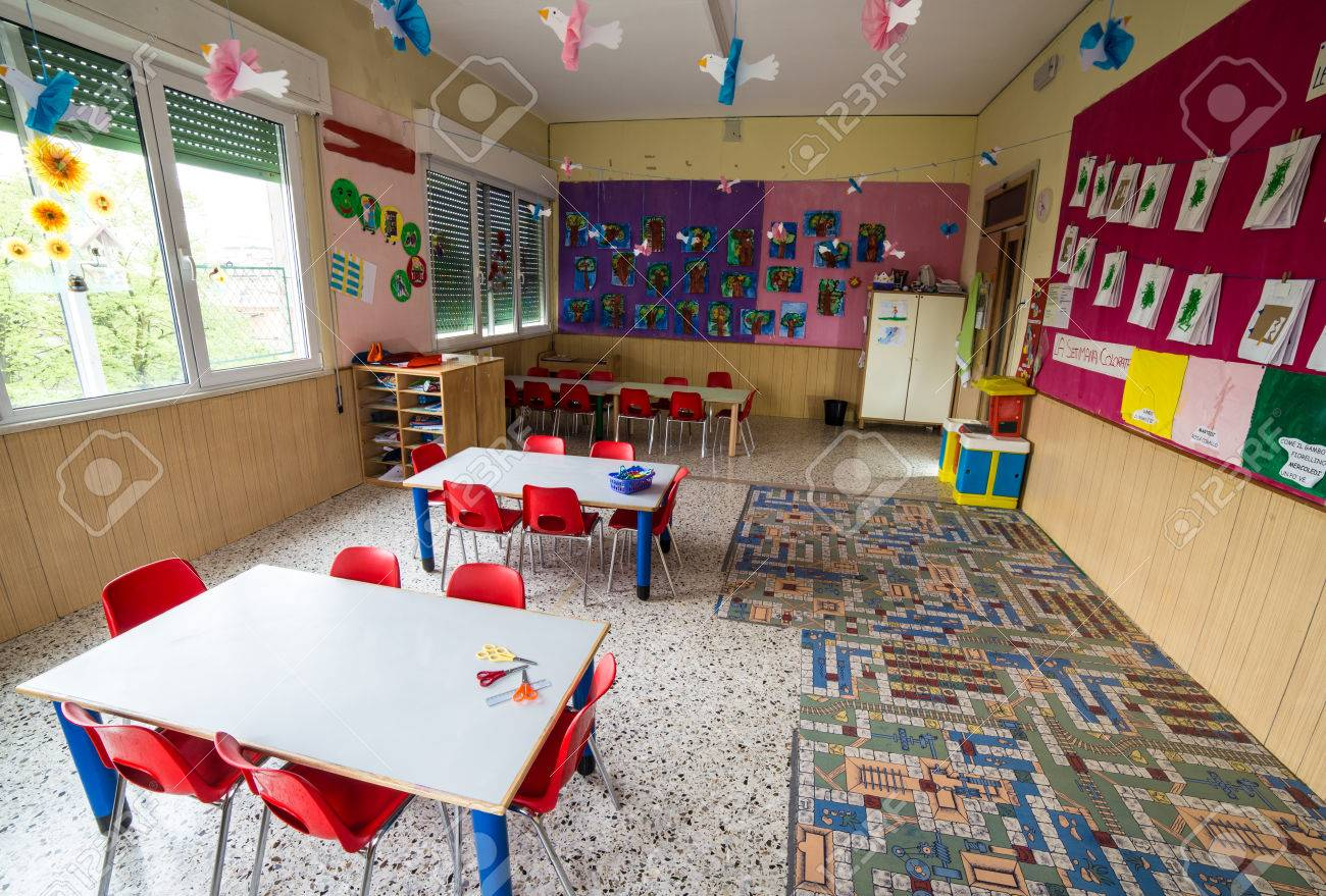 In A Nursery Class With Tables And Small Red Chairs For Children Stock Photo