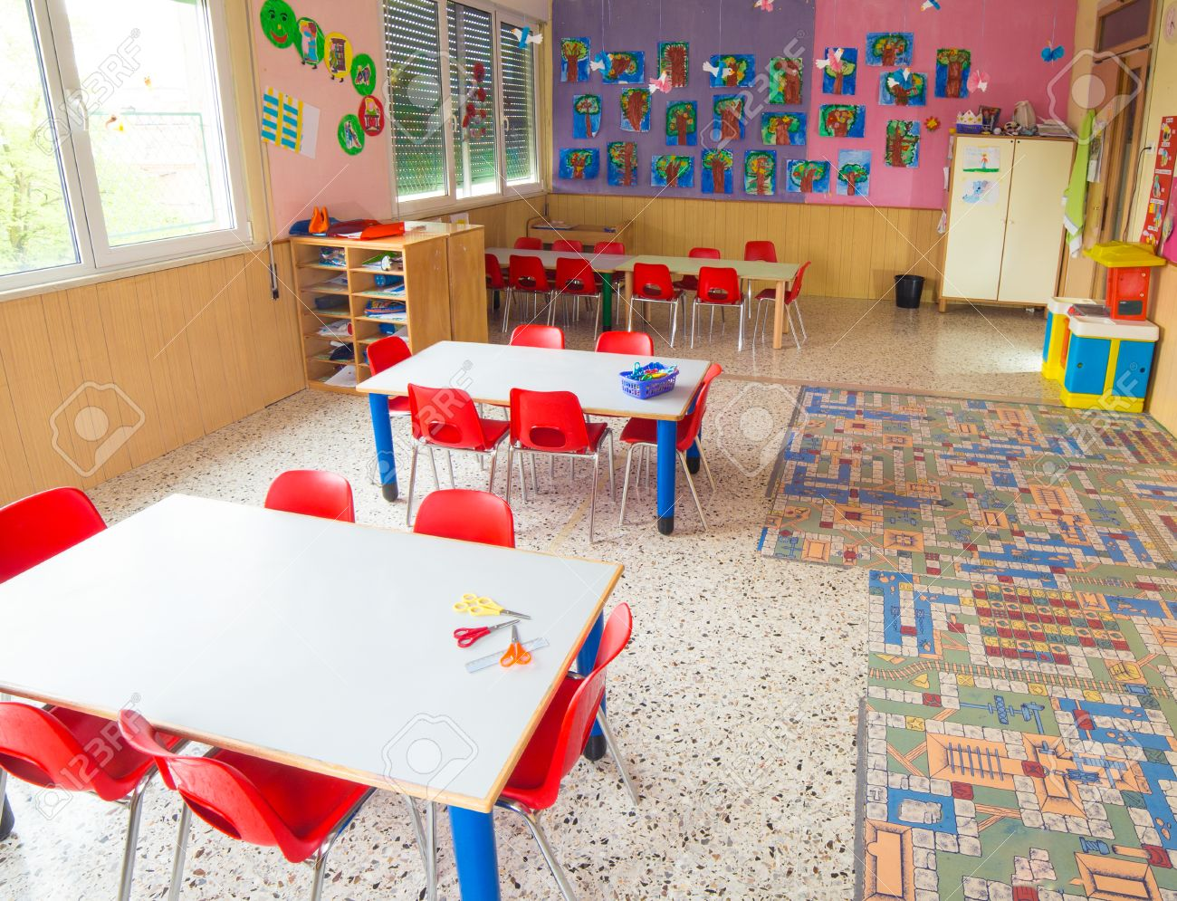 classromm of kindergarten with tables and small red chairs for children Stock Photo - 39267904