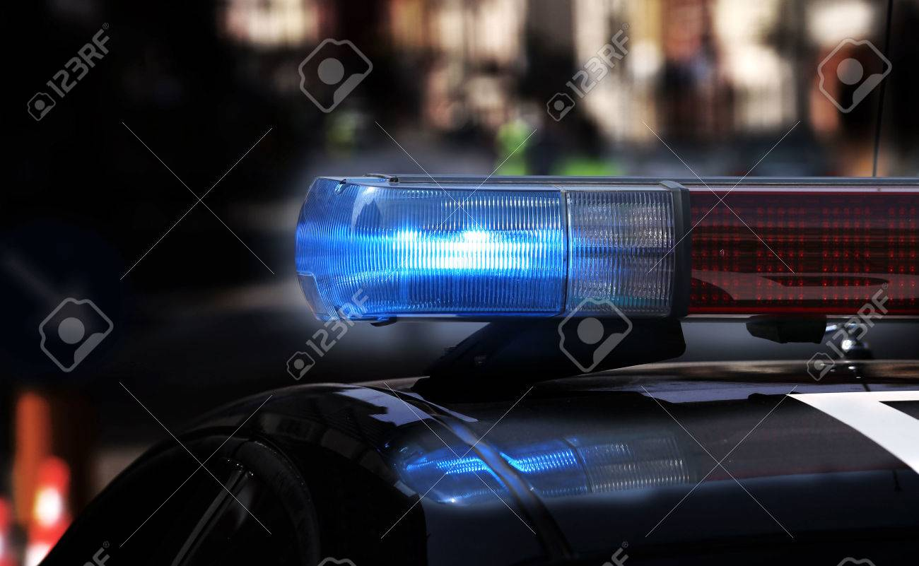 Blue flashing sirens of police car during the roadblock Stock Photo - 39484479