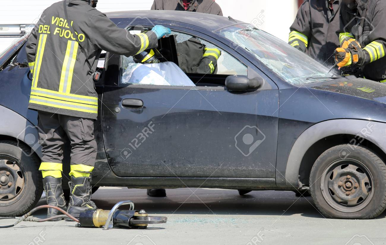 Firefighters During A Practice Of Traffic Accident Simulation Stock ...