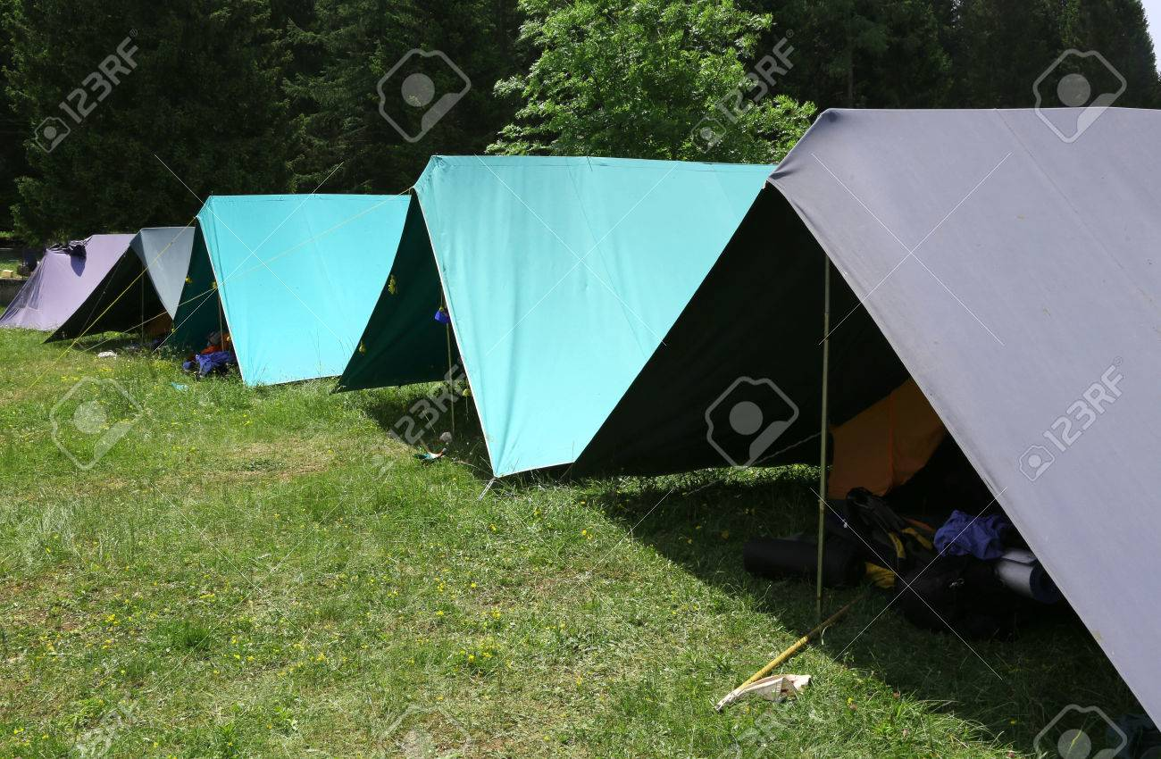 row of tents in the summer camp of the boyscout in the mountains