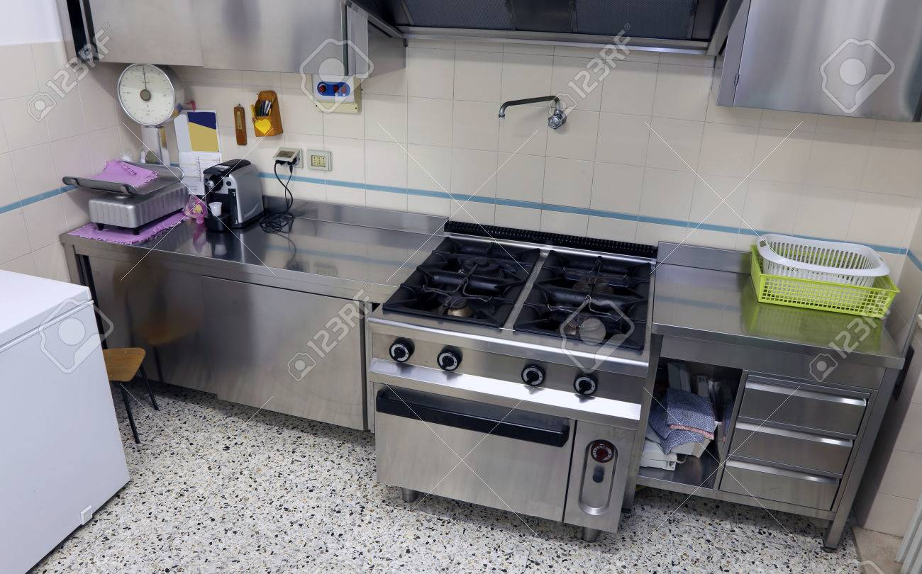 Industrial Kitchen With Big Steel Stove To Cook Lunches Many People Stock Photo