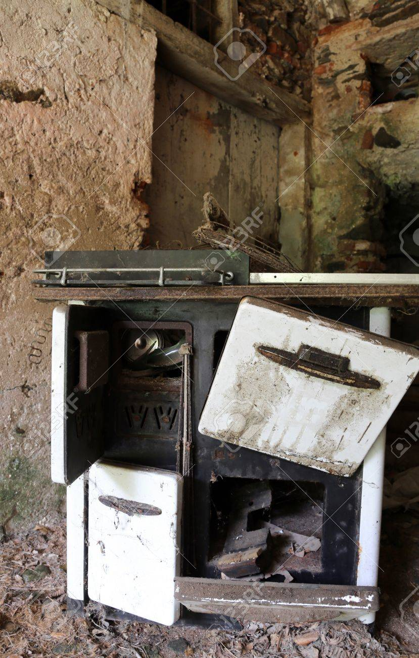 Ancient Wood Burning Stove Of Old Kitchen In An Old Abandoned House Stock  Photo