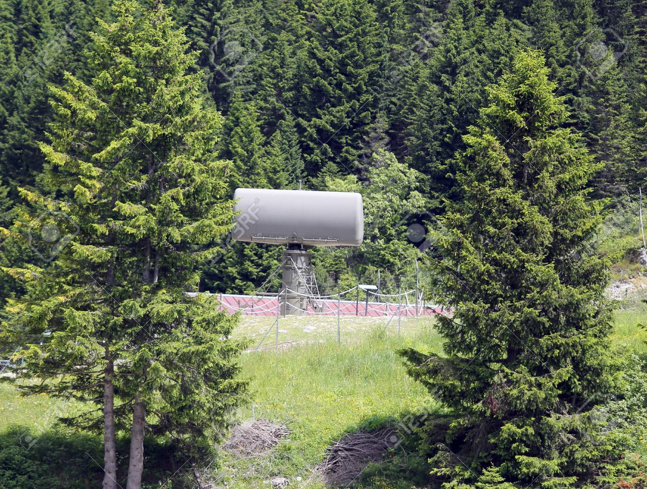 Green military radar in the secret base hidden in the forest