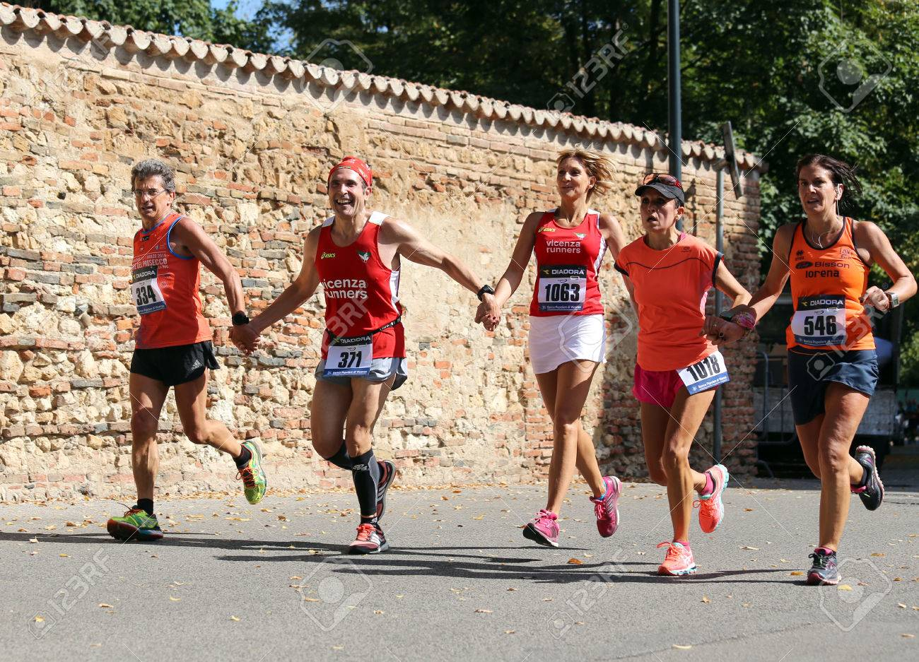 """Vicenza, Italy. 20th September 2015. Marathon runners during the race called """"Mezza di Vicenza"""" in city street of Vicenza in Northern Italy.The runners have raced meters 21097 - 45926202"""