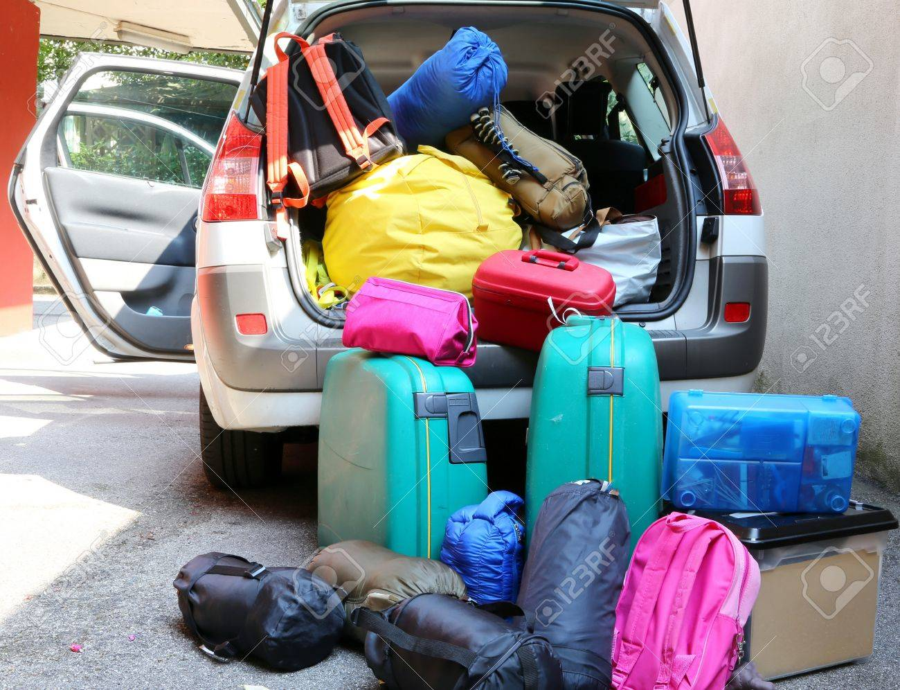Car Overloaded With Suitcases And Duffle Bag For Family Travel Stock Photo
