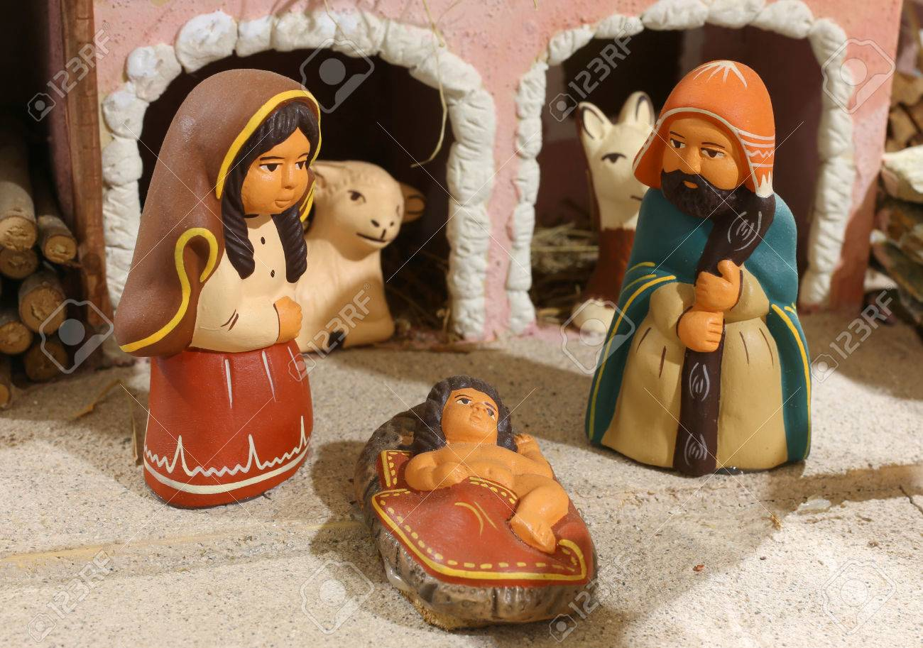 ethnic nativity scene in Latin America with baby Jesus and the holy family in the stable - 49948593