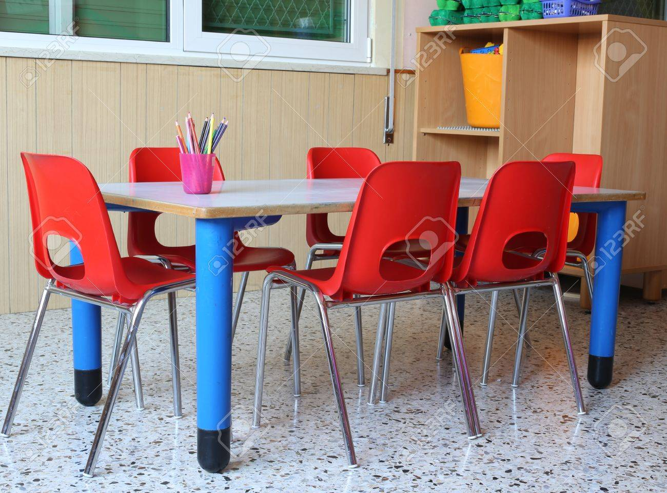 interiot classroom of a kindergarten with red chairs and small school tables Stock Photo - 50411370 : kindergarten chairs - Cheerinfomania.Com