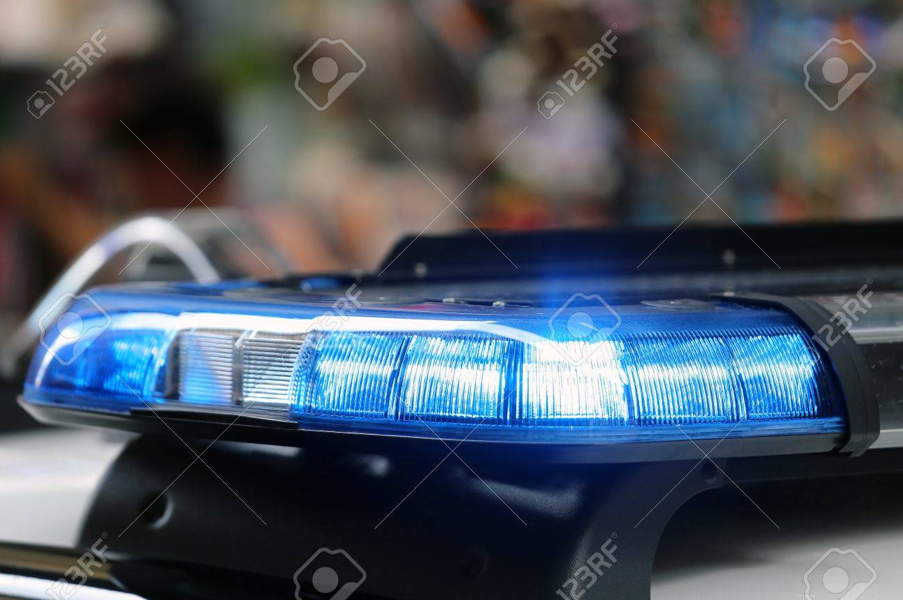 flashing lights of a police car in the big city stock photo, picture