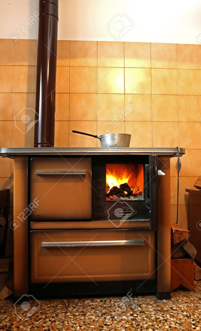 Old Wood Burning Stove In The Kitchen Of Mountain Home Stock Photo