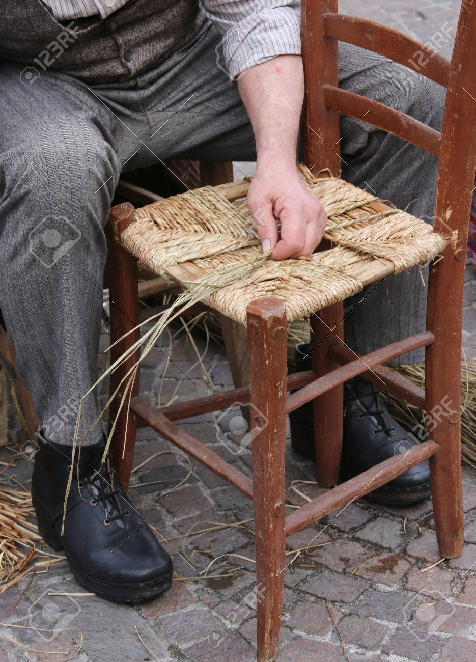 Senior Mender Of Chairs While With Straw Shelters The Old Wooden Stock Photo Picture And Royalty Free Image Image 58956497