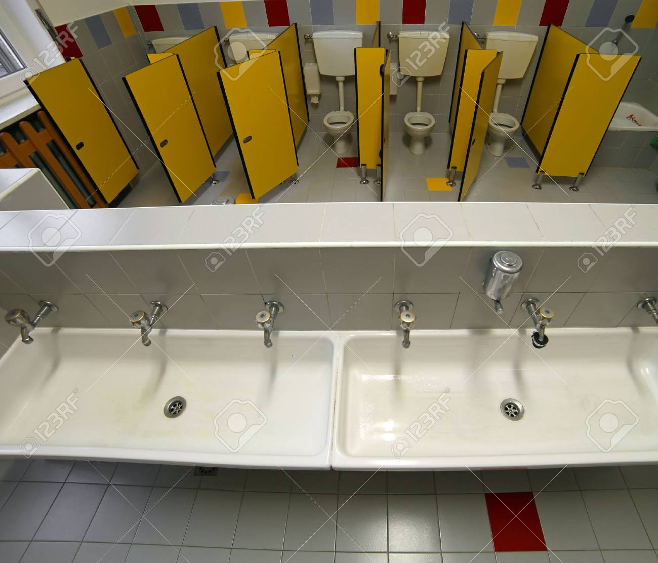Inside A Bathroom Of A Nursery School With Small Toilets And.. Stock ...