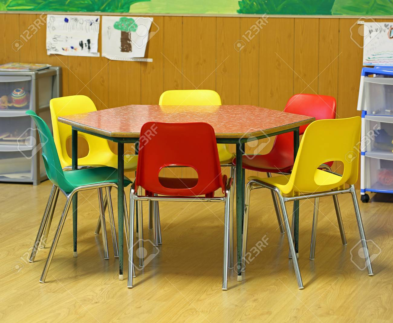 hexagonal table with small chairs in elementary school with parquet