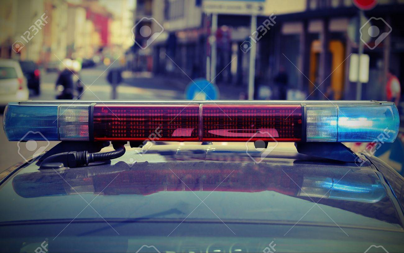 Red And Blue Flashing Lights Of The Police Car In The City Stock Photo    68246939