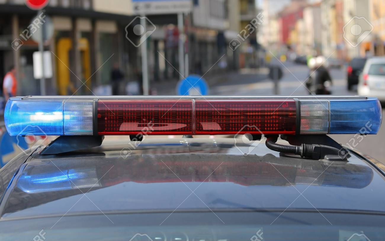 Red And Blue Flashing Lights Of The Police Car In The Checkpoint In The  Traffic Of