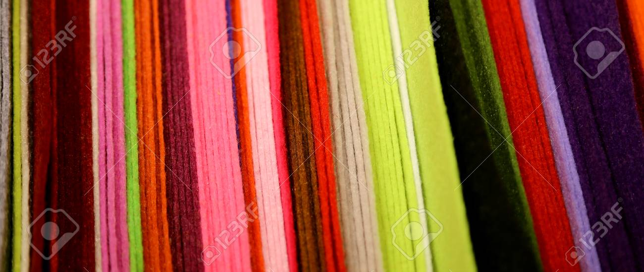 Background Of Clothes And Felt For Handicrafts Creations Stock Photo
