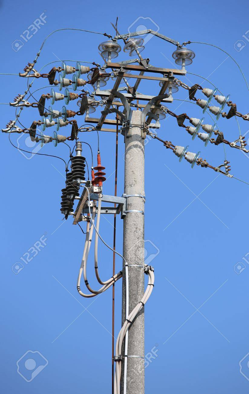 big switches of an overhead power line with concrete pole and