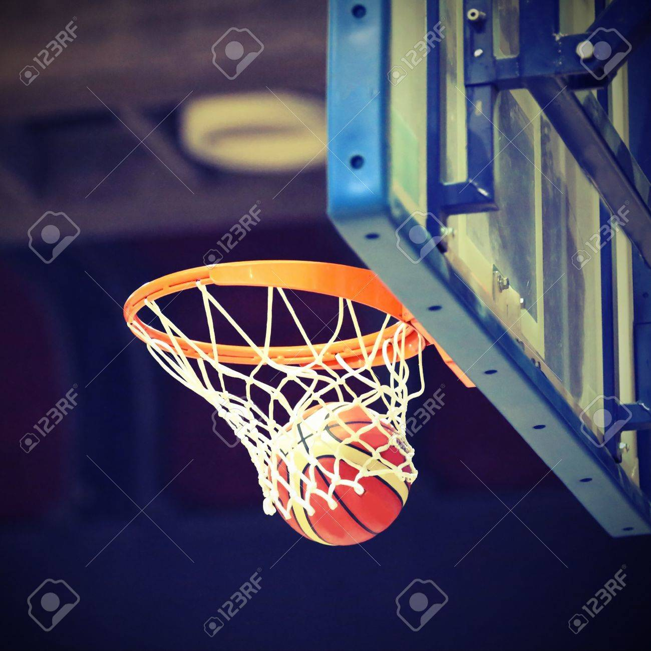basketball going into the basket after a fantastic shot stock photo