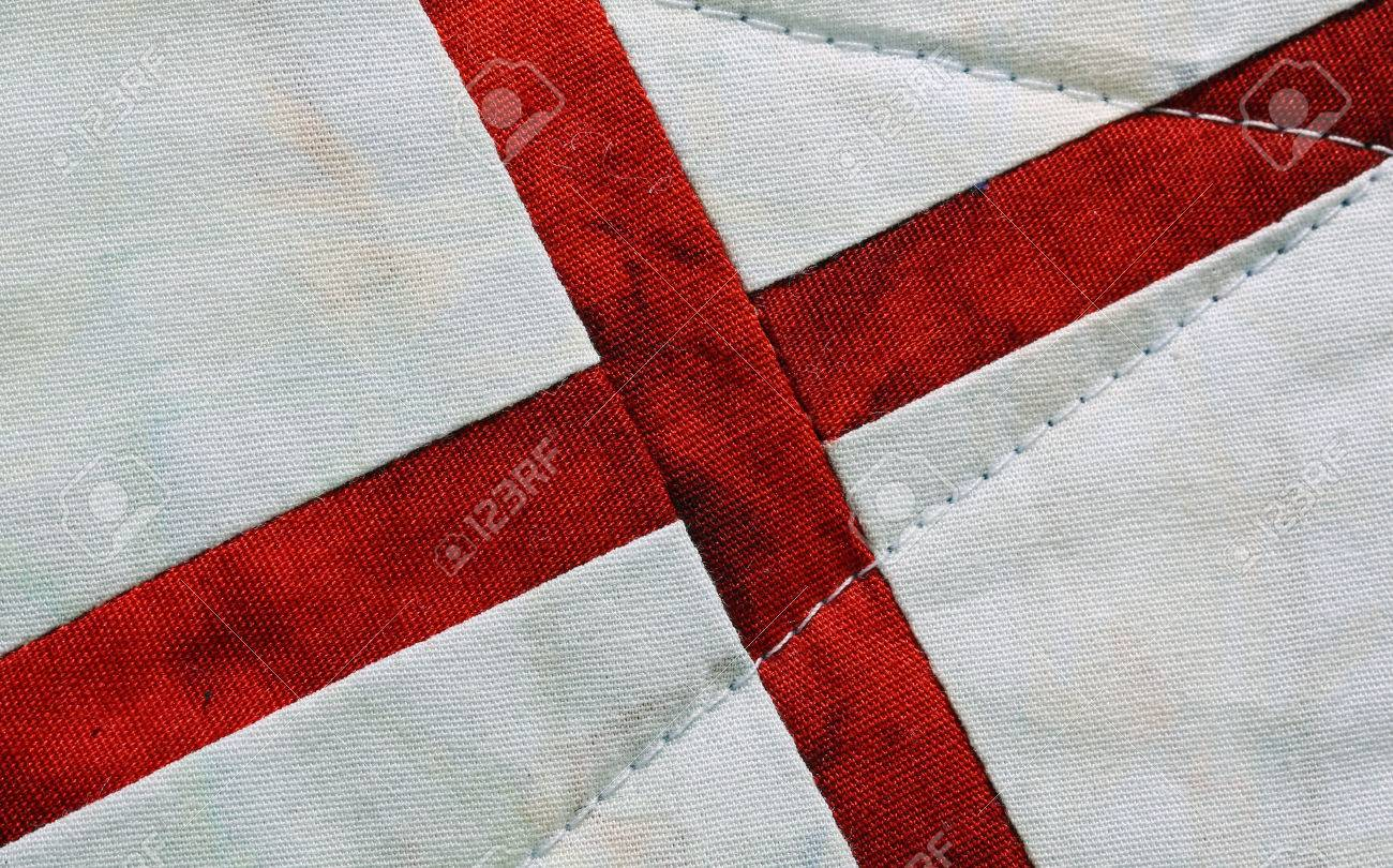 red embroidery typical of the medieval crusaders cross on a white