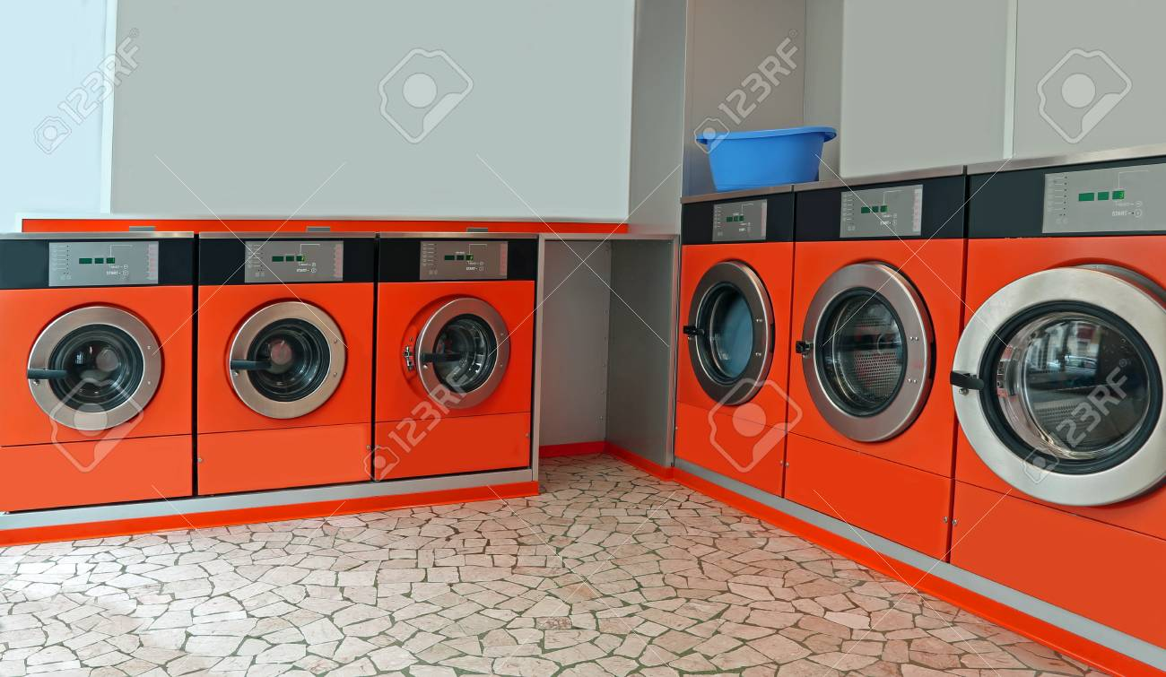 Automatic coin operated laundry with large portholes for washing