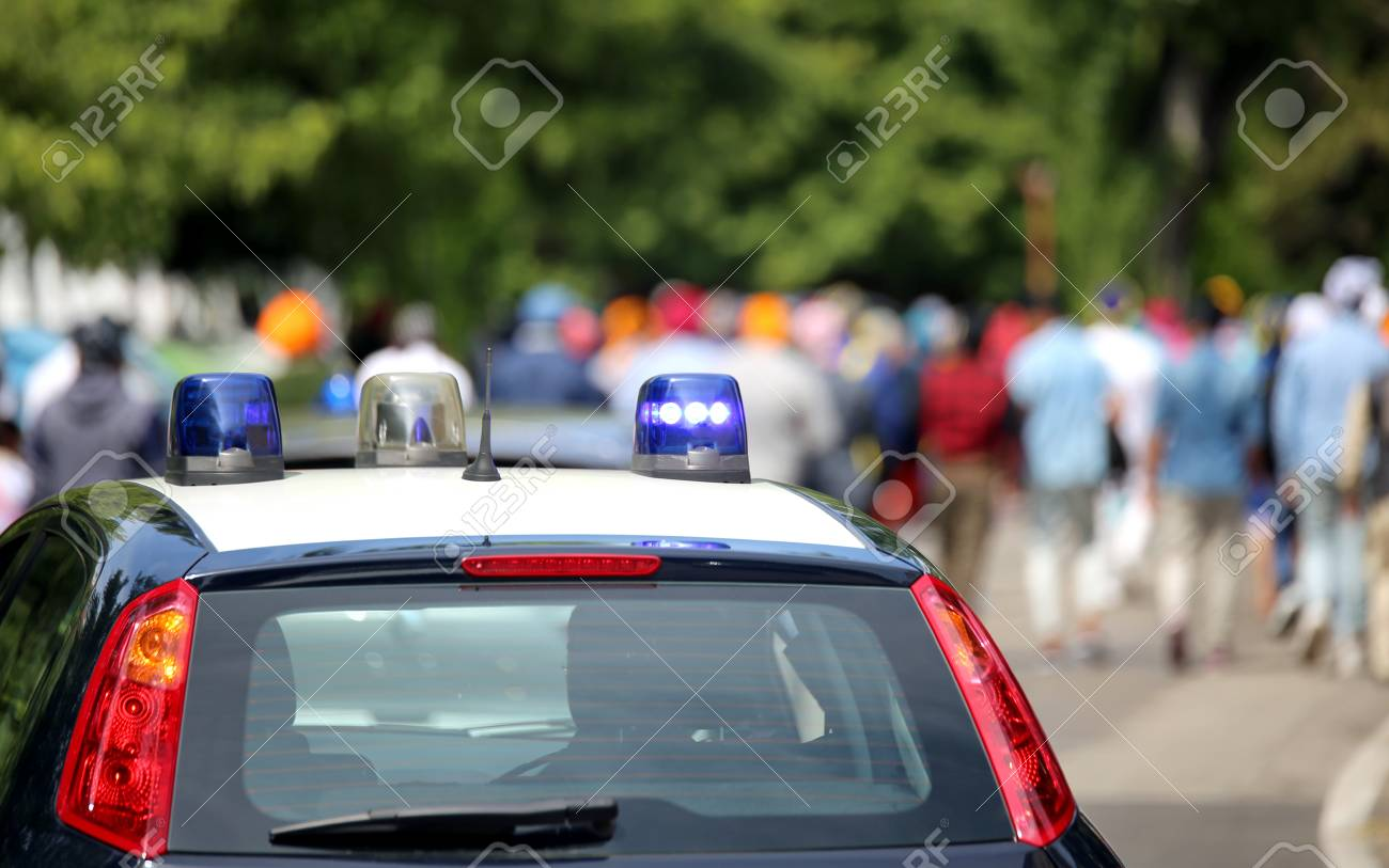 police cars with flashing sirens during the demonstration of.. stock