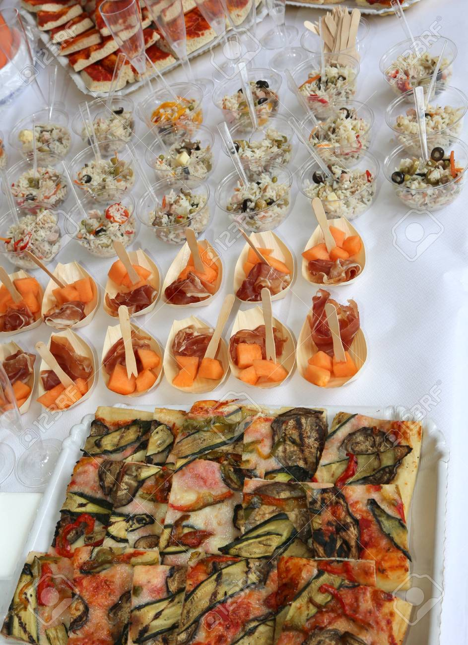 Table With Rice Pizza And Ham With Melon During The Wedding