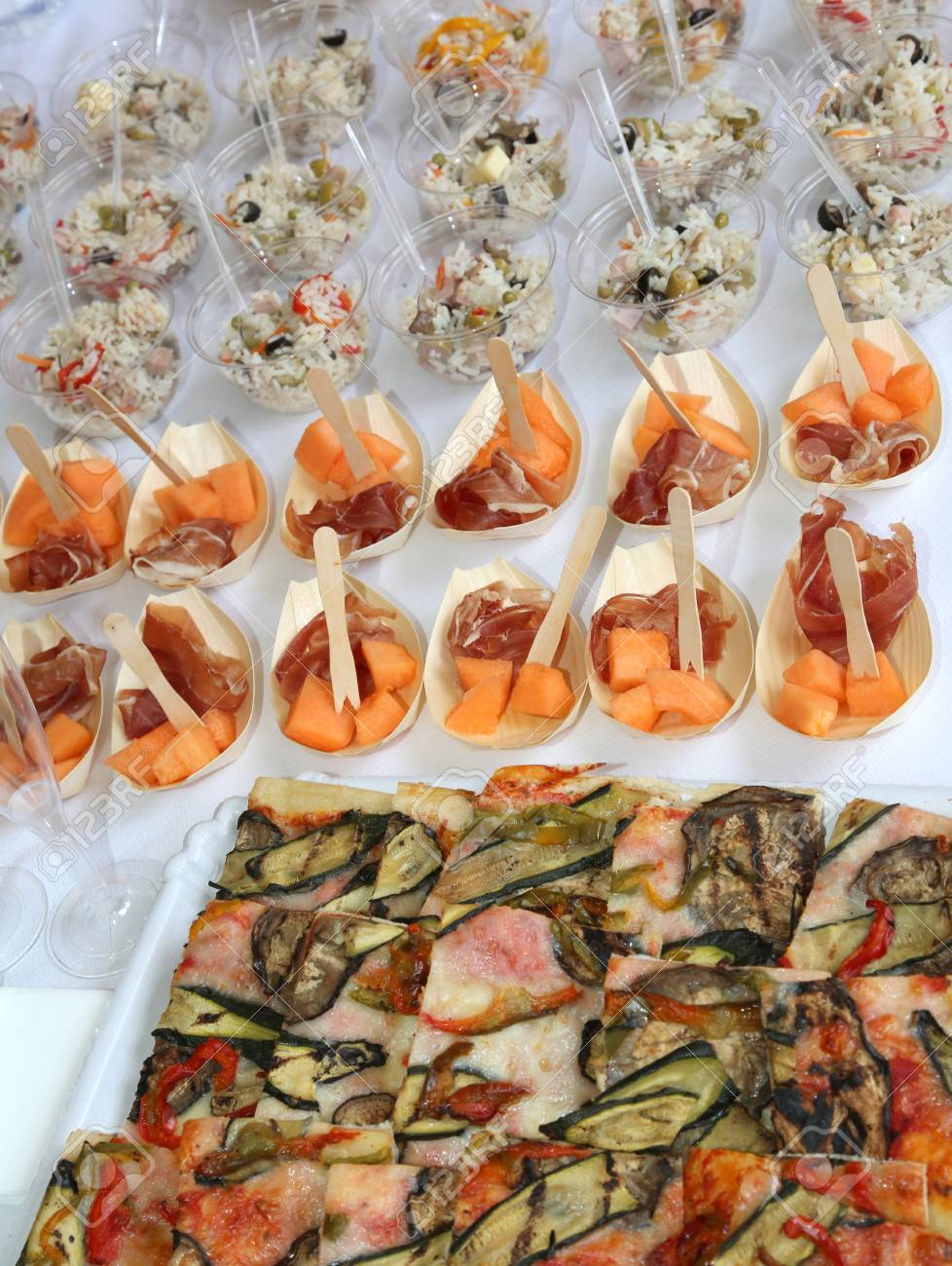 Large Buffet With Rice Pizza And Ham With Melon During The Wedding