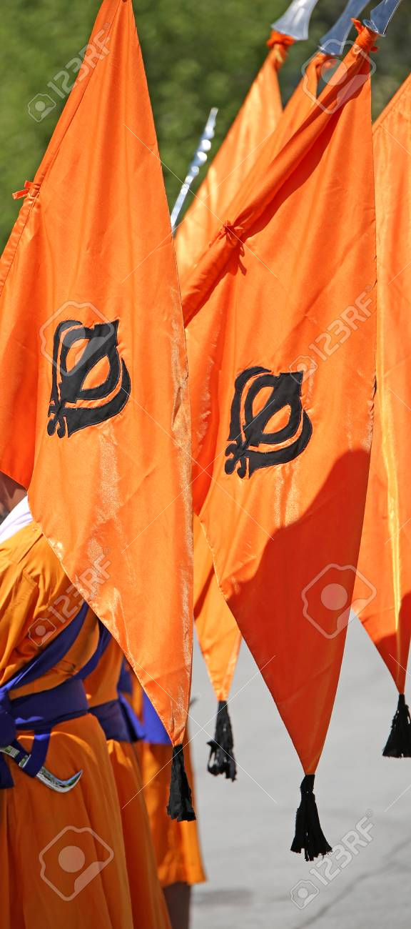 Big Orange Flag With Symbol Of Sikh Called Khanda During A Religious
