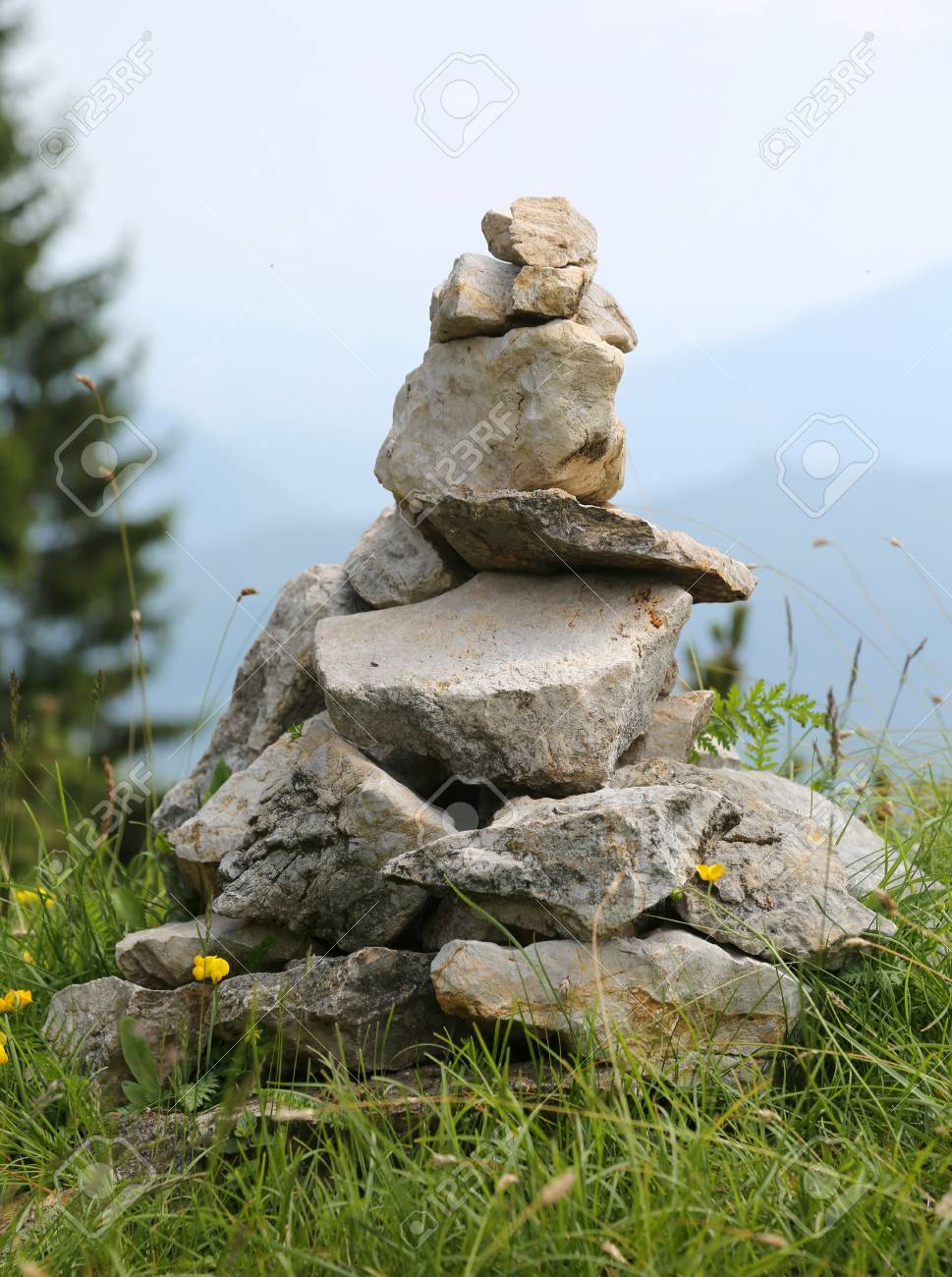 Ometto.Heap Of Stones Called Cairn Or Ometto In Italian Language This