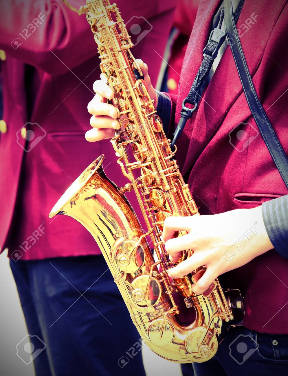 young player plays the saxophone with old toned effect - 121815499