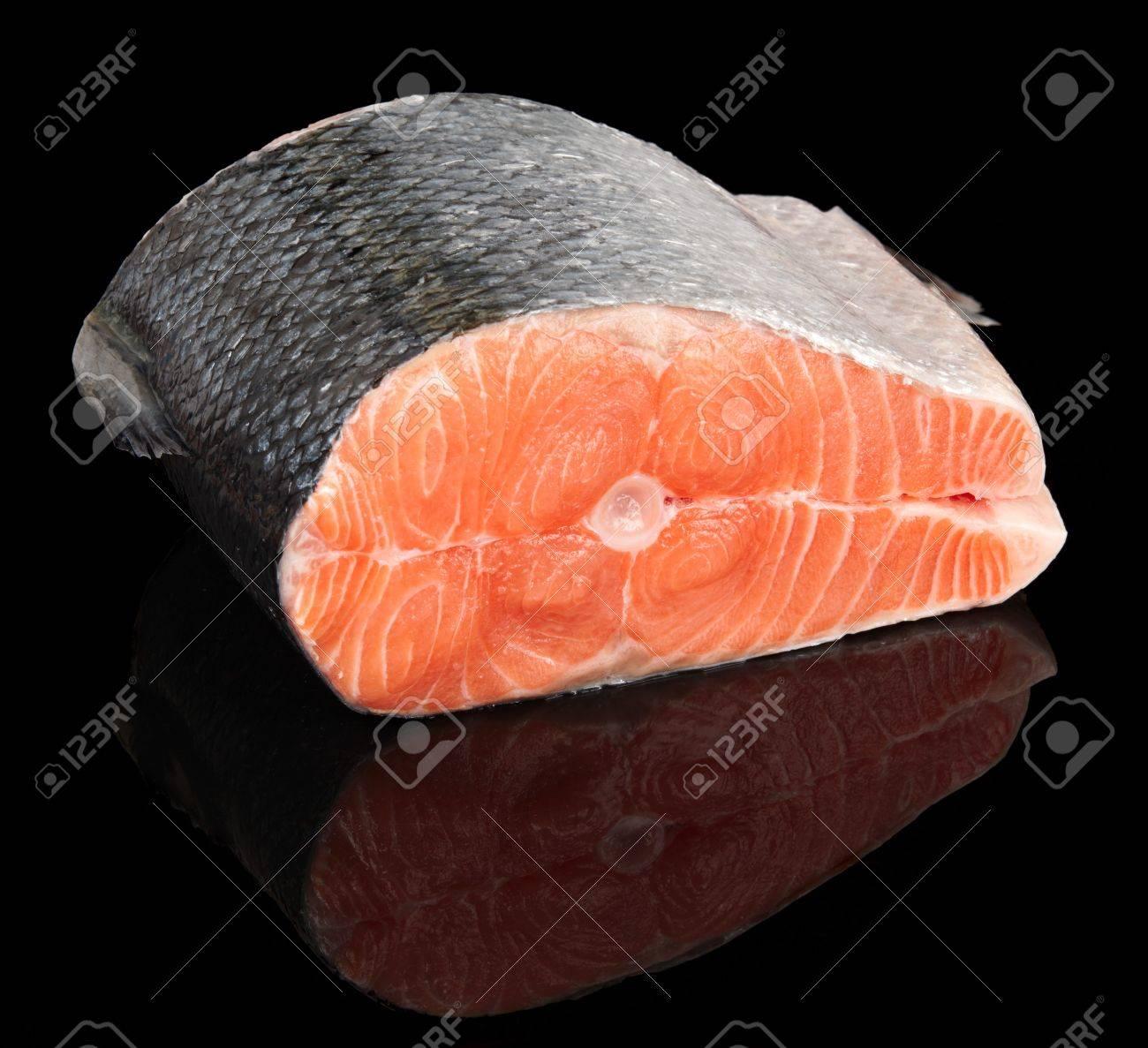 Piece of raw fresh salmon isolated on black background Stock Photo - 7880103