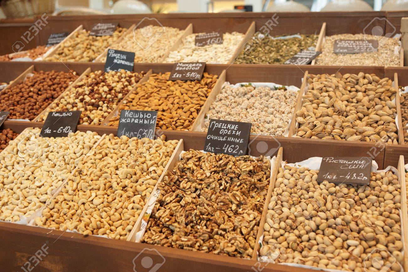Variety of nuts on street market, limited focus Stock Photo - 9188812
