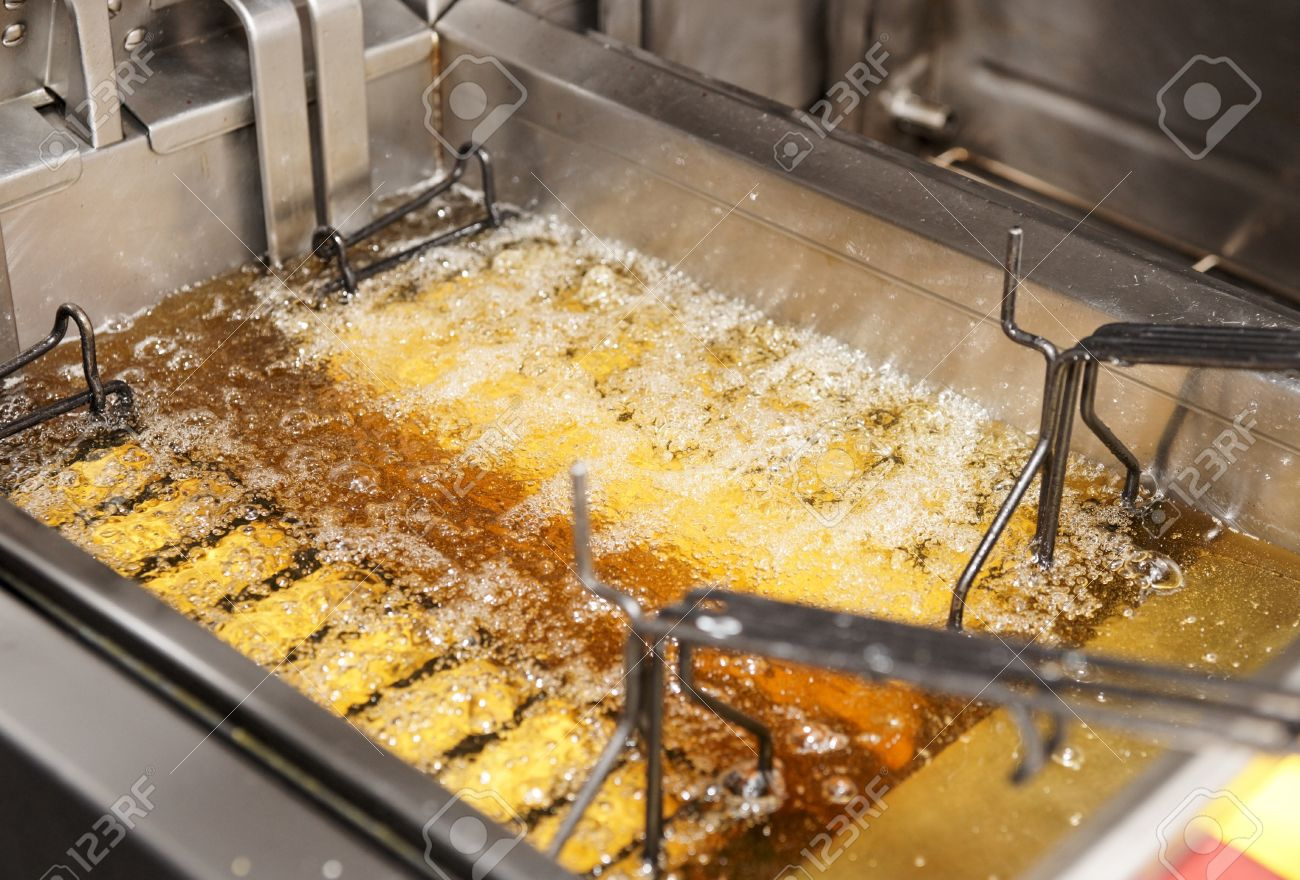 Deep Fryer With Boiling Oil On Restaurant Kitchen