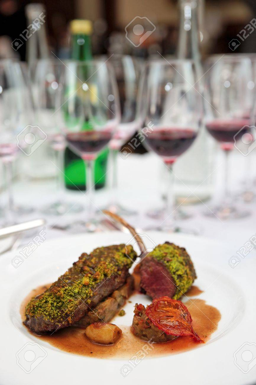Grilled rack of lamb with mint and pistachio on arranged table Stock Photo - 13970865