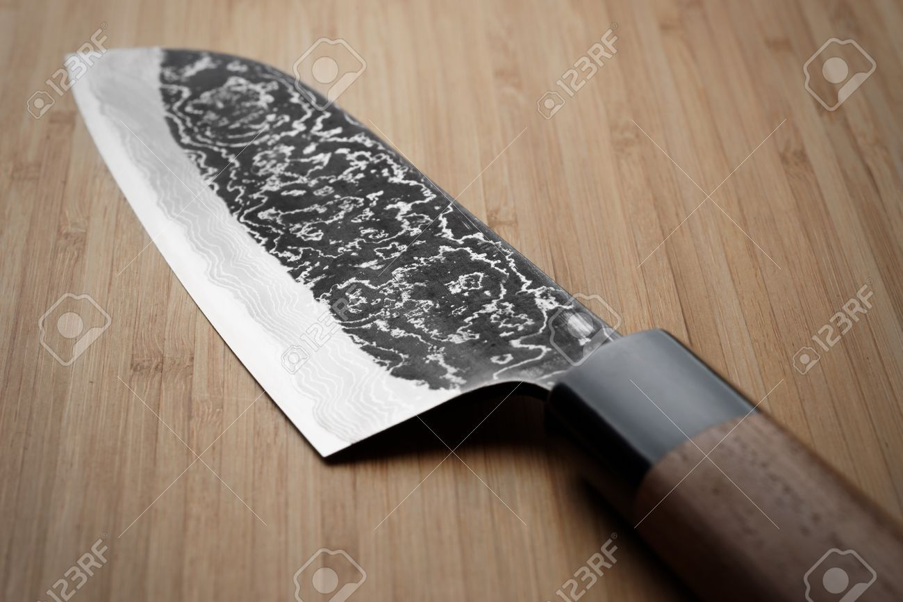 grungy image of damascus steel japanese kitchen knife stock photo