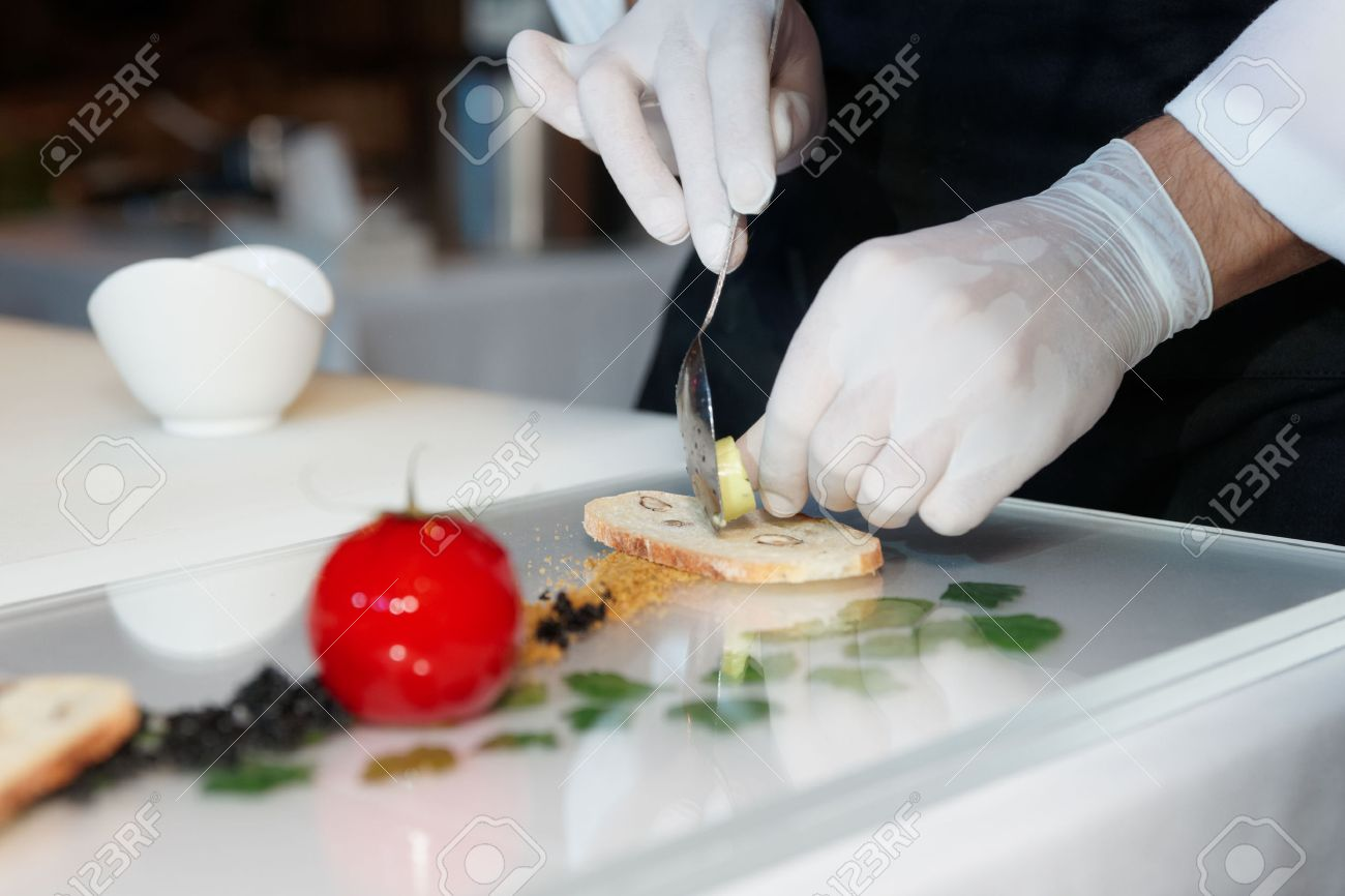 Chef is cooking an elegant gourmet dish - 34318217