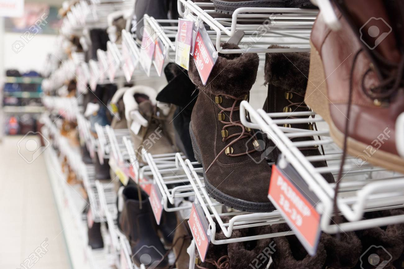 Cheap shoes in a supermarket, labels contain no copyright