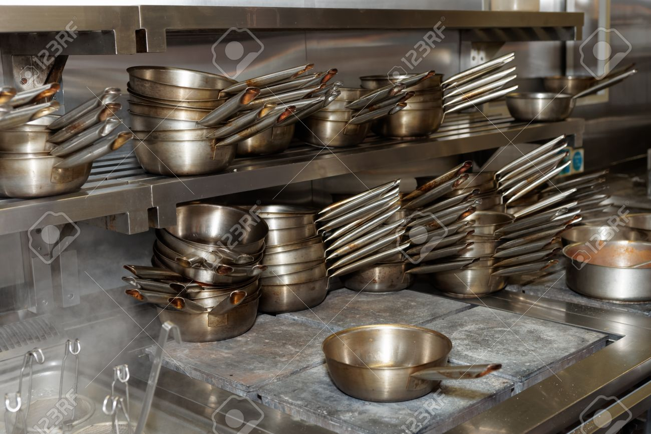 Lots Of Stainless Steel Pans, Professional Kitchen Equipment Stock Photo    57056066