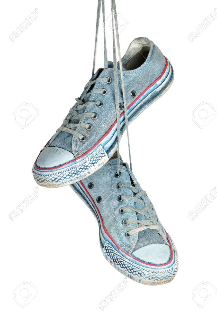 Pair of blue sneakers hangs on the laces isolated on a white background Standard-Bild - 27736023