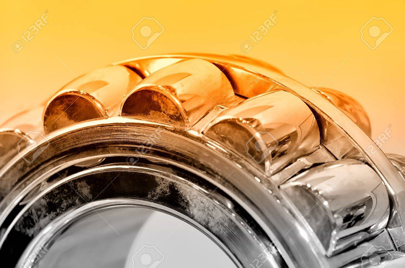 Industrial roller bearing on a light background. Red toning. Shallow depth of field, selective focus Standard-Bild - 85275007