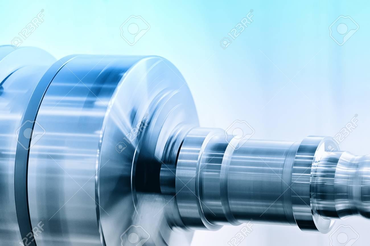 Rotating spindle of turning lathe and metal detail. Blue toning. Standard-Bild - 85275020