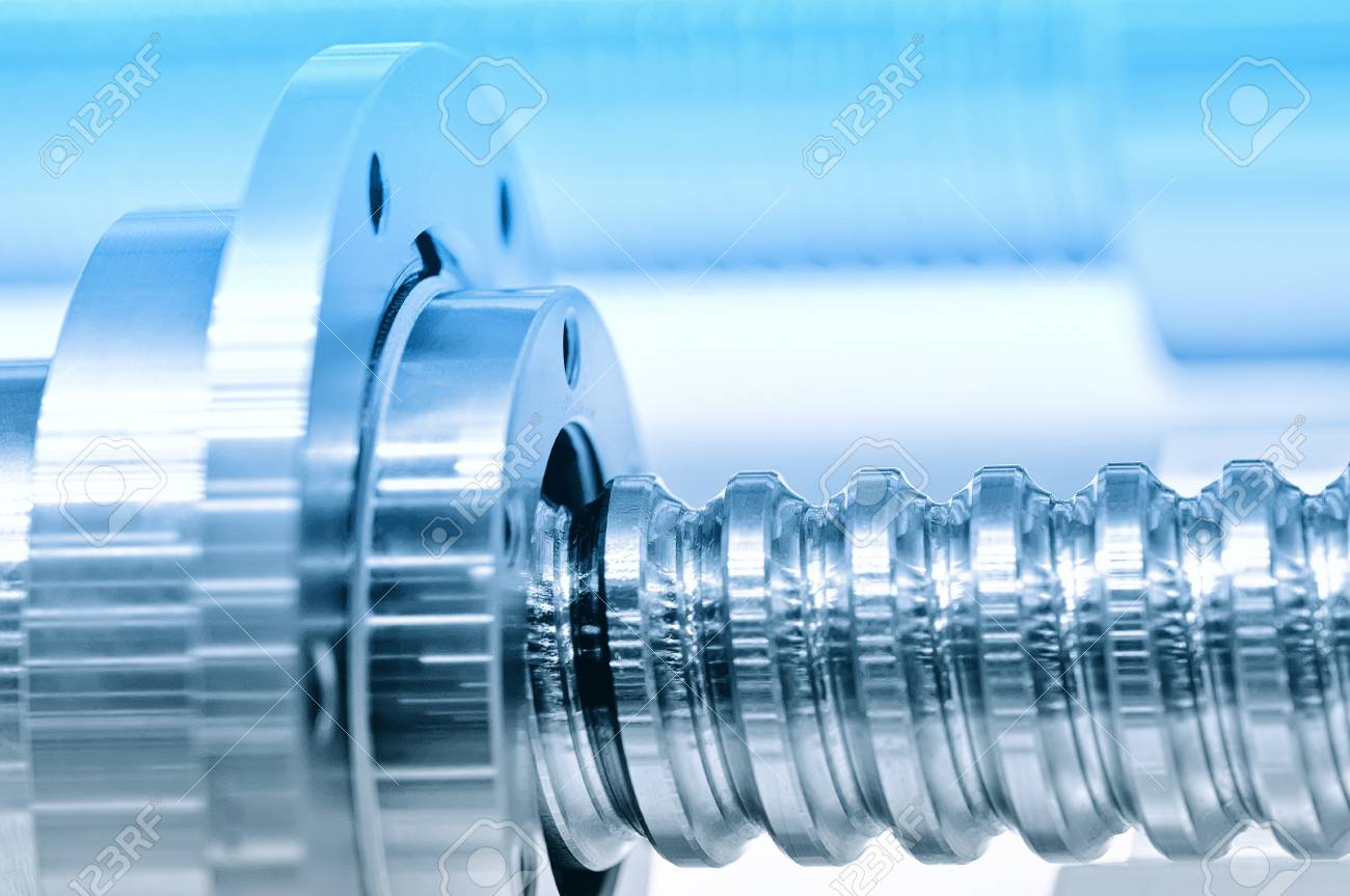 Steel rod with a screw thread and a metal round detail. Blue toning, small depth of field. Close up Standard-Bild - 85275018