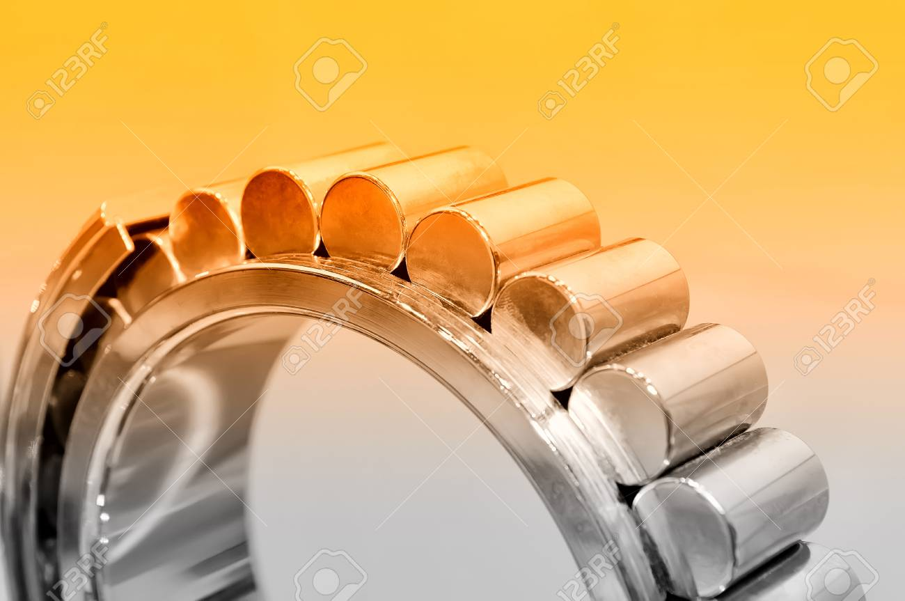 Industrial roller bearing on a light background. Red toning. Shallow depth of field, selective focus Standard-Bild - 85275019