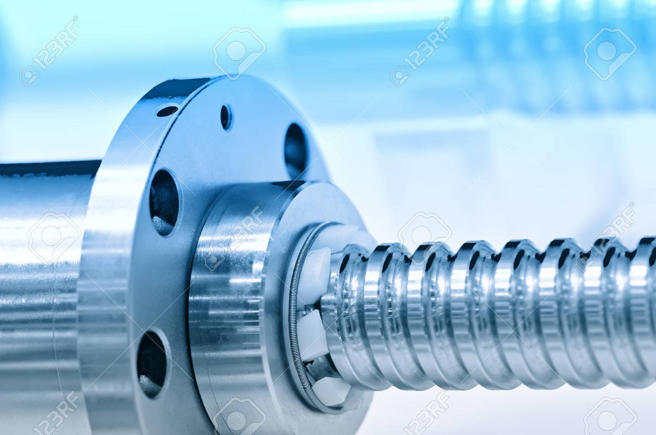 Steel rod with a screw thread and a metal round detail. Blue toning, small depth of field. Close up Standard-Bild - 85275039