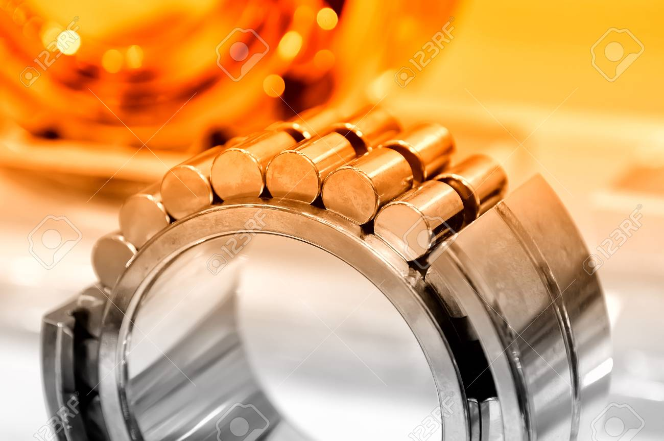 Industrial roller bearing on a light background. Red toning. Shallow depth of field, selective focus Standard-Bild - 85275041