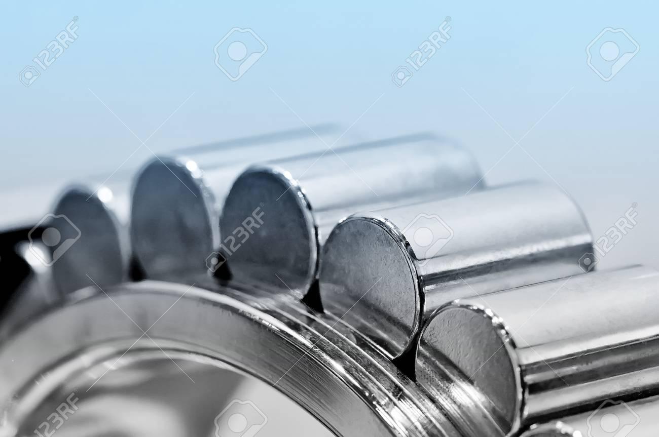Industrial roller bearing on a light background. Blue toning. Shallow depth of field, selective focus Standard-Bild - 85348927