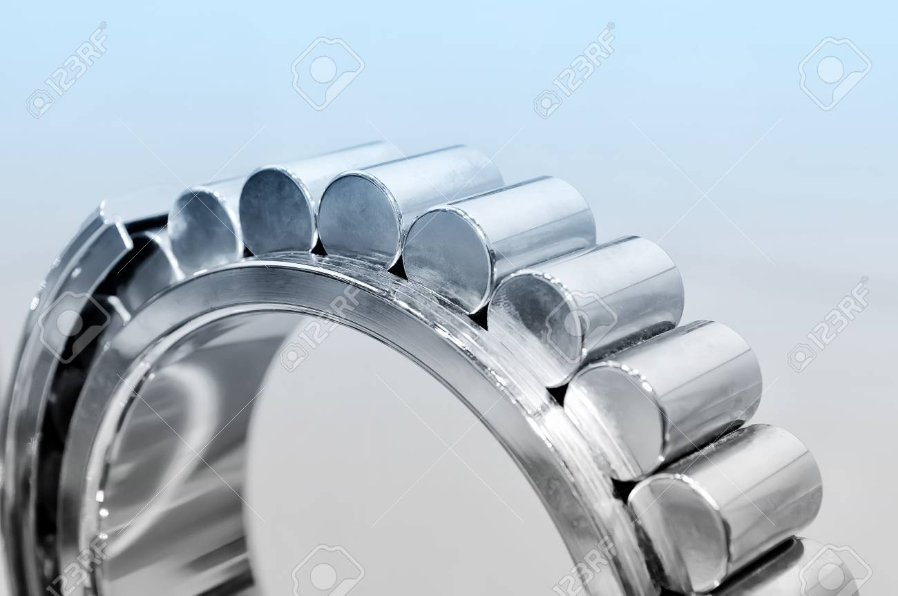 Industrial roller bearing on a light background. Blue toning. Shallow depth of field, selective focus Standard-Bild - 85348929